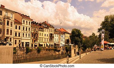 LJUBLJANA, SLOVENIA - JULY 28, 2014: Old town embankment in...