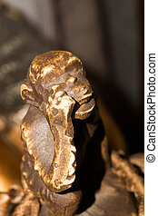 Monkey Statuette - Macro of small wooden statuette of...