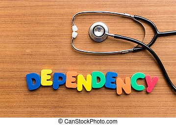 DEPENDENCY colorful word on the wooden background