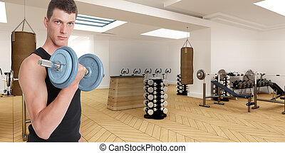 Body building  - Young man in a gym lifting a dumbbell
