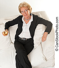 Senior lady with a glass of wine
