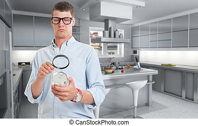 Food inspection in kitchen - Young man examining a can...