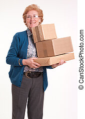 Happy senior woman holding a pile of packages