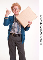 Satisfied senior woman holding a package