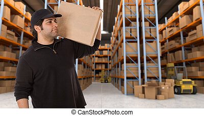 warehouse delivery g - Deliveryman carrying a parcel in a...