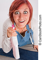 crazy Spray attack - Woman with crazy eyes leaning on an...