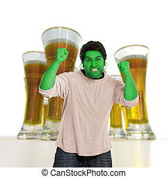 Beer monster - Green young man in a fit of rage with beers...