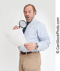Shocking clause - Man with a shocked expression analyzing a...