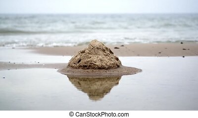 Sand Castle on Beach - Weathered Sand Castle on Beach...