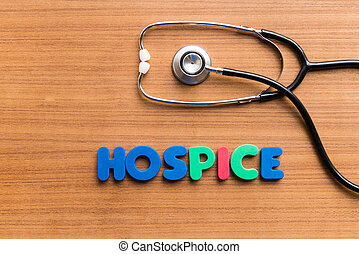 hospice colorful word on the wooden background
