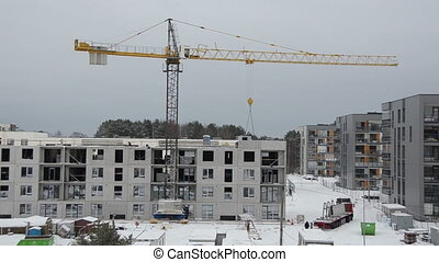 snowstorm construction - Winter construction site with...