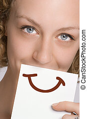 Paint a smile - A woman covering her mouth with a piece of...