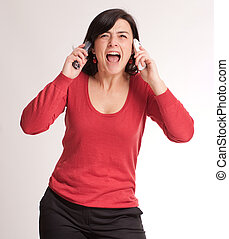 Hysterical brunette talking with two phones - Hysterical...