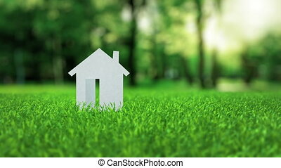 White paper house animation on green nice summer grass...