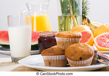 brunch - a lovely brunch with muffins, fruit, milk and juice