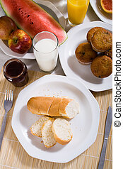 brunch - overhead view of brunch food with french bread,...