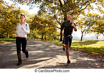 Running - Two runners in a park with slight motion blur