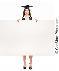 Young, beautiful and happy graduate girl with a blank banner...