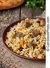 Traditional arabic spicy rice food with meat, onion carrot...