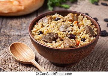 Traditional uzbek food called pilaf cooked with fried lamb...