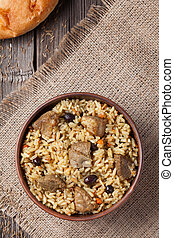 Pilaf is spicy indian food cooked with lot of rice, fried...