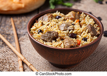 Traditional asian gourmet meal called pilaf cooked with...