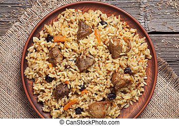 Dish of pilaf, national uzbek spicy meal with meat, rice,...