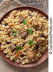 Pilaf is traditional delicious dish with fried meat, rise,...