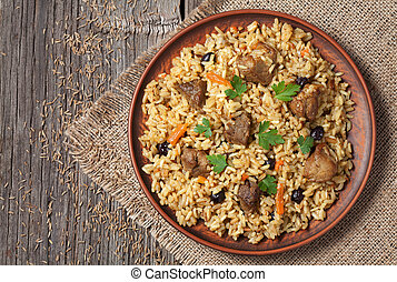 Arabic national rice food called pilaf cooked with fried...