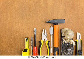 Construction tools on wood background - Set of work tools on...