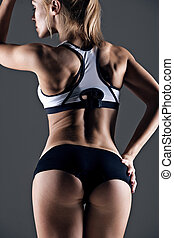 fitness woman - young female athlete back, trained buttocks,...