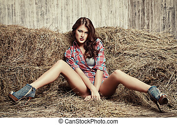 passionate vilage - Seductive young woman in jeans shorts...