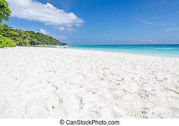 Crystal clear sea and white sand beach at Tachai island,...