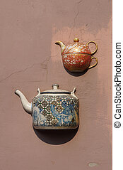Ancient teapots on wall in Vilnius - Ancient teapots...