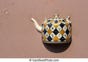 Ancient teapot on facade in Vilnius, Lithuania - Ancient...
