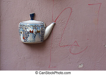 Old teapot on wall in Vilnius - Ancient teapot embedded in...