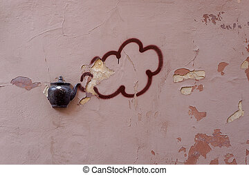 Old teapot on wall in Vilnius - Old teapot embedded in...