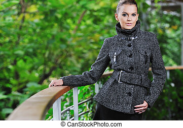 woman fashion outdoor - young woman posing in fashionable...