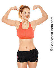 Athletic woman in sportswear - Athletic young woman flexing...