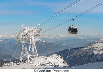 aerial ski lift arrival on french alps background