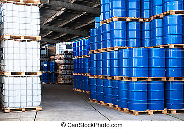 Blue drums and container - Blue drums and IBC container in a...