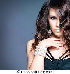 High-end retouched portrait of young and attractive woman