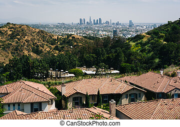 View of houses and the Los Angeles Skyline from Mulholland...