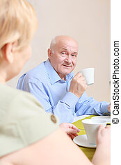 Couple drinks tea at home - Breakfast together. Close-up of...