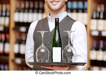 Sommelier with a tray and glasses