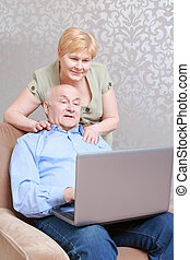 Couple works on the laptop