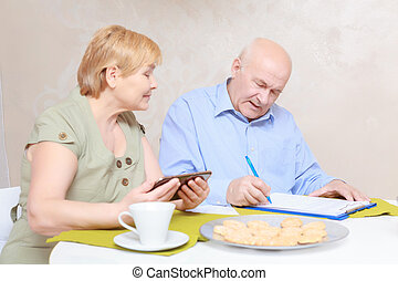 Couple works with documents - Communication on business...