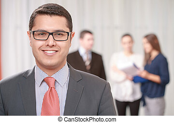 Businessman with a team at the meeting - Team work. Young...