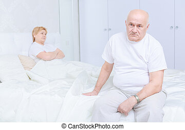 Man sitting on the bed - Disappointment Sad senior man...