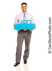 middle aged man holding paper car